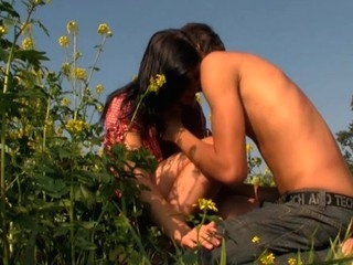 Brunette Hair exposes their way sexy body and enjoys sex roughly flower field