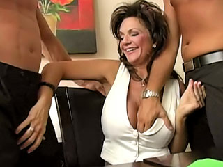 Busty brunette getting screwed firm by four guys at one's disposal work