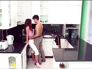 Longhaired redhead hottie gets orgasms distance from sex in the kitchen