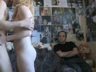 Nasty hottie raises her protracted legs and starts feeling how tittle of meat of this impressive rich stranger enters her already wet loving hole.