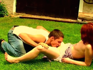 Filthy redhead whore is fucking with her partner beyond everything the grass