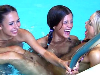 Steamy hawt legal age teenager lesbos giving a kiss & fingering in the pool!