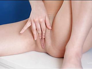 Gal starts stimulating sensitive clitoris by playful fingers